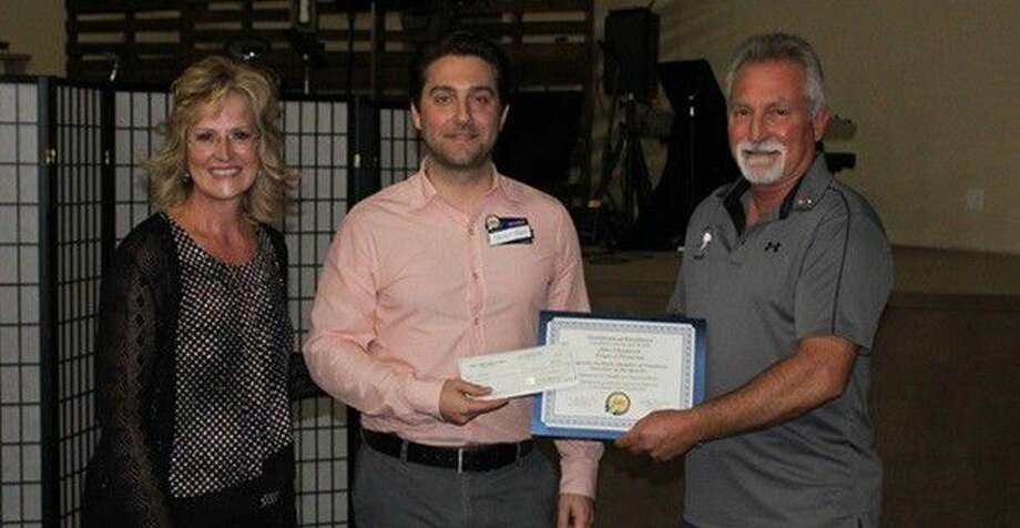 Magnolia Parkway Chamber of Commerce President Kelly Hamann, Kellen Moore with Woodforest National Bank, and John Chadwick of Triple J Firearms. Photo: Submitted Photo