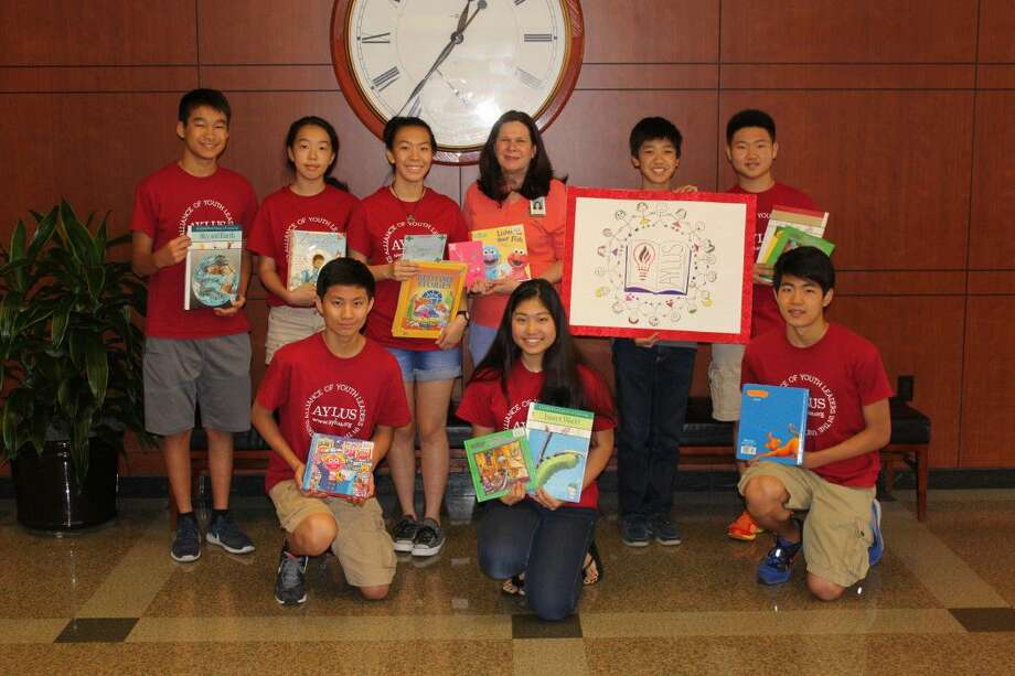 Members of the Alliance of Youth Leaders in the United States (AYLUS) donate books to Memorial Hermann Southwest Hospital. Pictured in the top row from left are Kevin Chen, Lauren Wang, Emily Wang, Beth Burris Bell, Eric Li and Jonathan Liu; and in the front from left are Tony Liu, Clio Sun and Jason Jiang. Photo: Submitted Photo