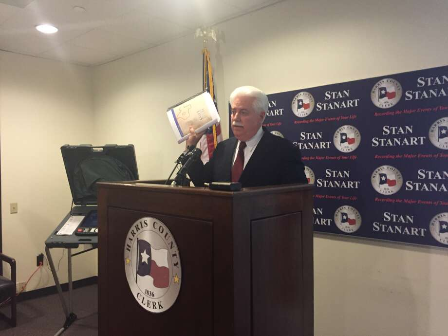 During a Thursday press conference, Harris County Clerk Stan Stanart holds up a copy of the 596-page Texas Election Code to stress the meticulous detail behind conducting an election.
