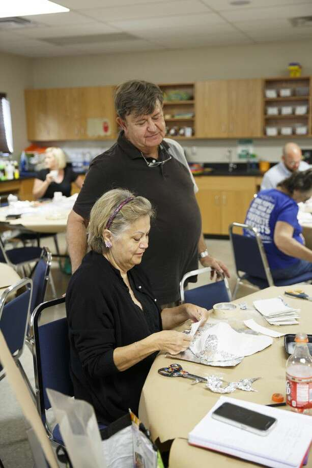 Spring Branch ISD Teacher Maria Casares works with artist and consultant Joe Culotta at the You Gotta Have Art workshop held at HCDE July 20-21. Photo: Submitted Photo