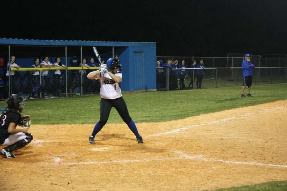 Amber Macy (9) goes up to bat in the final and decisive inning. Photo: JACOB MCADAMS