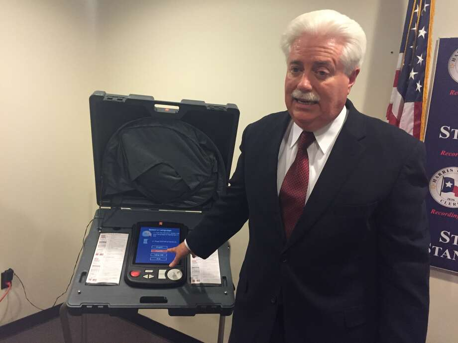 Harris County Clerk Stan Stanart exhibits a voting machine used in Harris County, which he said can't be hacked because it isn't connected to the internet.