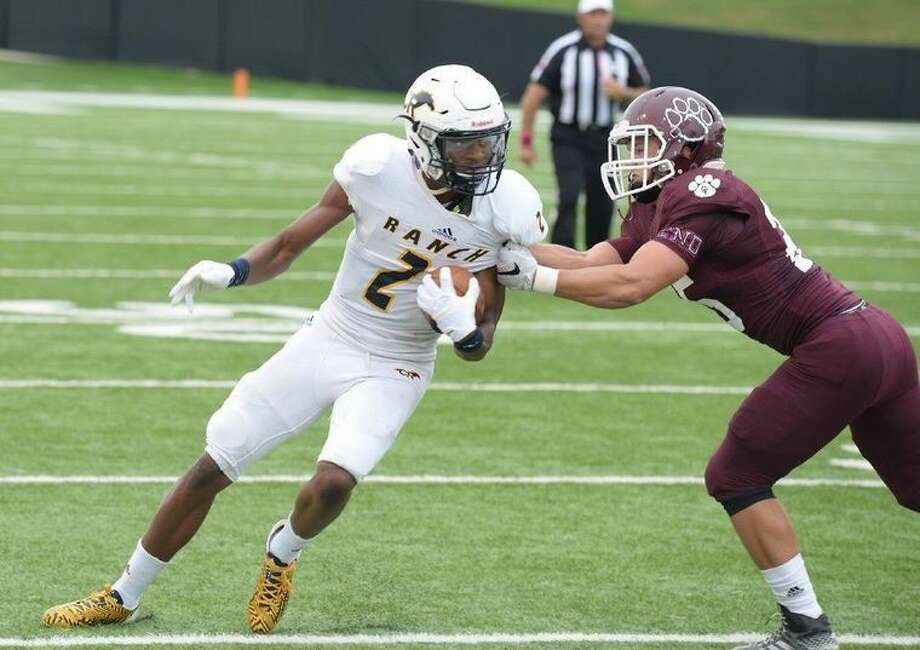 Cypress Ranch High School receiver R.J. Sneed (2) looks for yardage after the catch during a 2015 District 17-6A matchup with Cy-Fair High School. Sneed was a terror in the return game for Cy Ranch, and - combined with his threat as a wide out - he is a player to watch this season. Photo: Tony Gaines