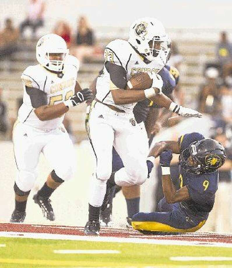 Conroe tailback Dontrell Dock is expected to return from a foot injury against MacArthur. Photo: Jason Fochtman