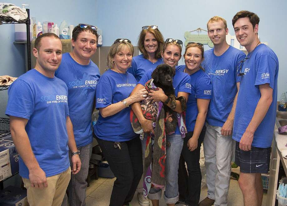 Nearly 20 employees from Southwest Energy donated their time to do volunteer work at the Montgomery County Animal Shelter.