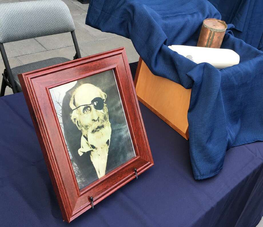 The cremated remains and a photo of Maine Civil War soldier Jewett Williams are displayed in Salem, Ore., Monday before the ashes are handed over for a motorcycle journey across the country to Williams' home state where he will be buried with military honors. Williams served in the 20th Maine Regiment and died in 1922 at an Oregon insane asylum.