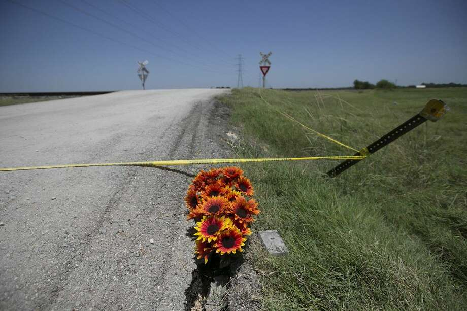 Flowers and a New Testament lay near crime scene tape at the scene of Saturday's hot air balloon crash near Lockhart, Monday. Sixteen people were killed in the crash.