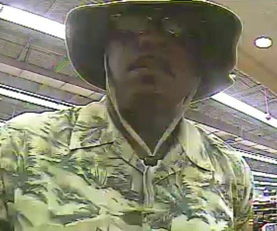 The FBI released bank surveillance photos of the bank robber.