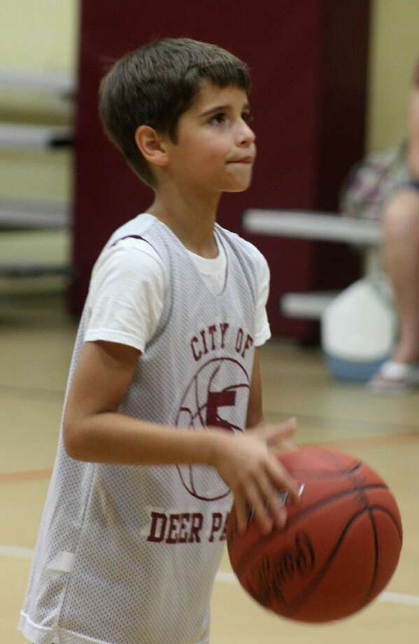 Displaying a great deal of concentration, Kayden Shak eyes another made foul shot duing his victory in the Deer Park Super Swish competition at the Community Center. His dad played for South Houston High School's basketball team in the mid-1990s. Photo: Robert Avery
