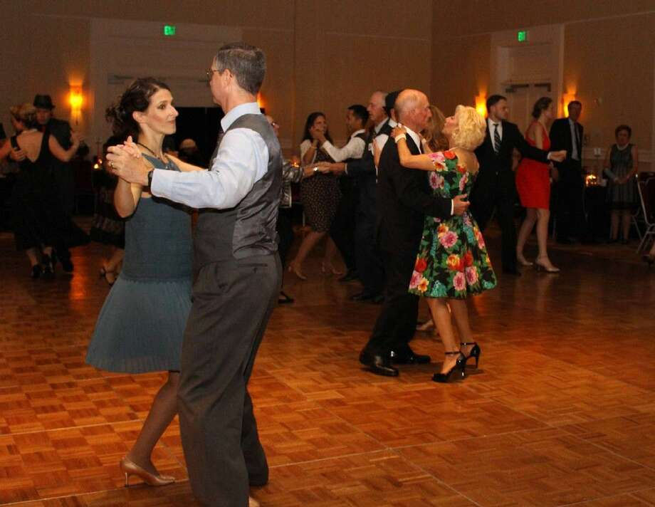 Maria and Tom Cassidy, the couple on the left, and Wayne Woodruff and Janie Kaufman, on the right, along with other members of The Woodlands Dance Club take part in one of the dances the group hosts. TWDC offers three socials and three dinner dances each year for those who favor ballroom and other styles of dancing.