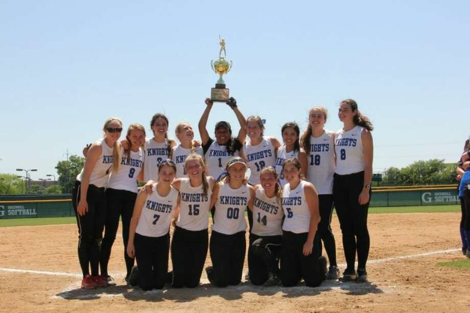 The Episcopal girls softball team holds up their Southwest Preparatory Conference championship trophy after the Knights clinched the Division I title with a 7-2 triumph over Houston Christian in Dallas. The Knights are led by head coach Kim Randolph and in his 20 years at the helm, they won the SPC title nine times. The Knights were a young team with only one senior on the squad so they hope to be a contender in the SPC for the next few years.