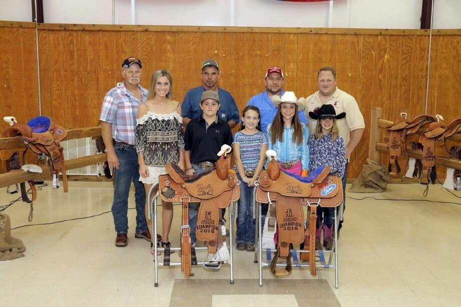 Winners with saddles, left to right: (back row) Phillip Alexander, Roland Buchanan, Kevin Graber and Dan Ziegelman. (Front row) Brook Warwick, Slade Watson, Sadie Howell, Kyla Casey and Crista Goodridge.