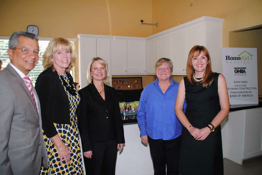 Left to right are David Ruiz, marketing manager at Bank of America; Bette Moser and Cindy Hinson, HomeAid Houston; Leslie King, Greymark Construction; and Casey Watts Morgan, GHBA, who attended the dedication of the HomeAid Houston CARE Project for Santa Maria Hostel.