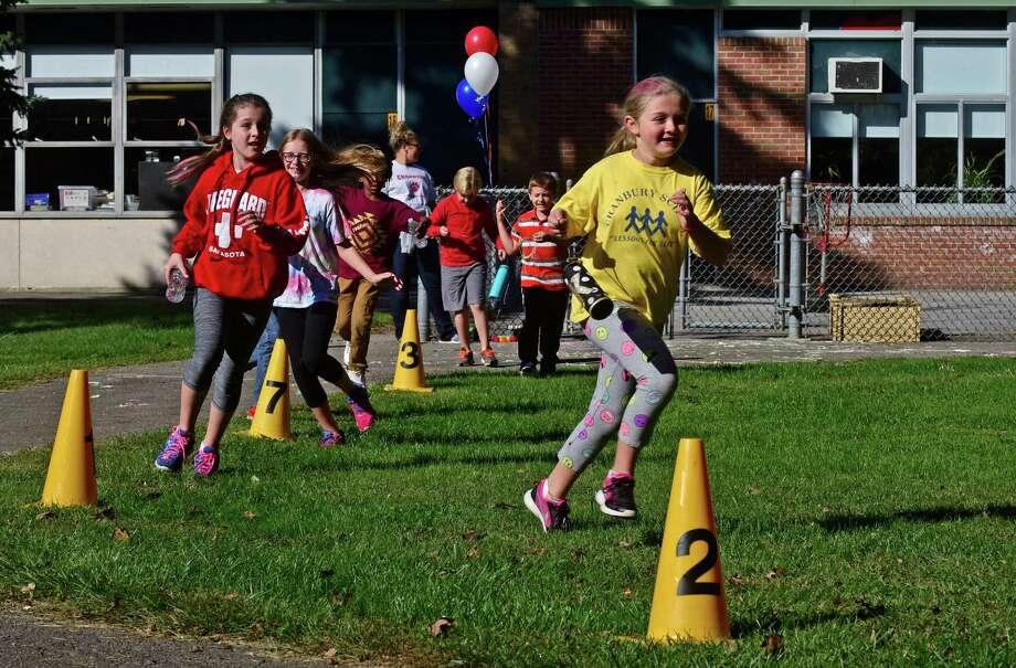 Cranbury Elementary School 4th grader, Kate Putterman, leads her class in the school's annual Walk-a-thon Thursday, October 6, 2016, in Norwalk, Conn. Photo: Erik Trautmann / Hearst Connecticut Media / Norwalk Hour
