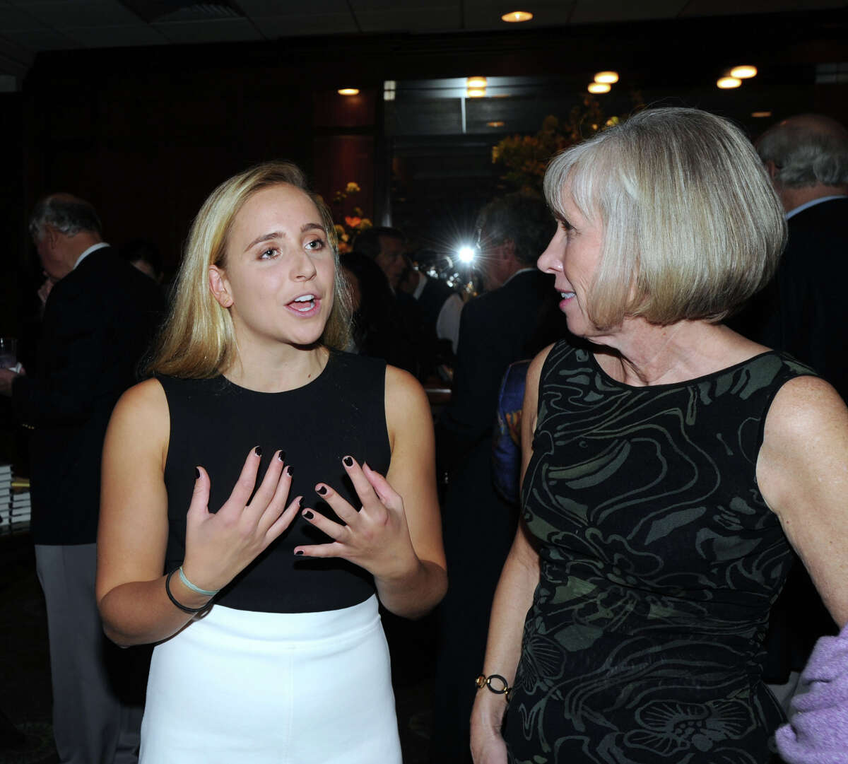 """At left, Greenwich High School senior Olivia Hallisey, 18, speaks with Debra Mecky, the executive director of the Greenwich Historical Society during the society's """"An Evening with Lesley Stahl"""" at the Greenwich Country Club, Greenwich, Conn., Wednesday night, Oct. 5, 2016. Hallisey was honored with a Greenwich Makes History award during the event for being a 2015 Google Science Fair Grand Prize Winner. Stahl, an awarding winning broadcast journalist was on hand to promote her book """"Becoming Grandma: The Joy and Science of the New Grandparenting."""" Stahl also spoke during the event."""