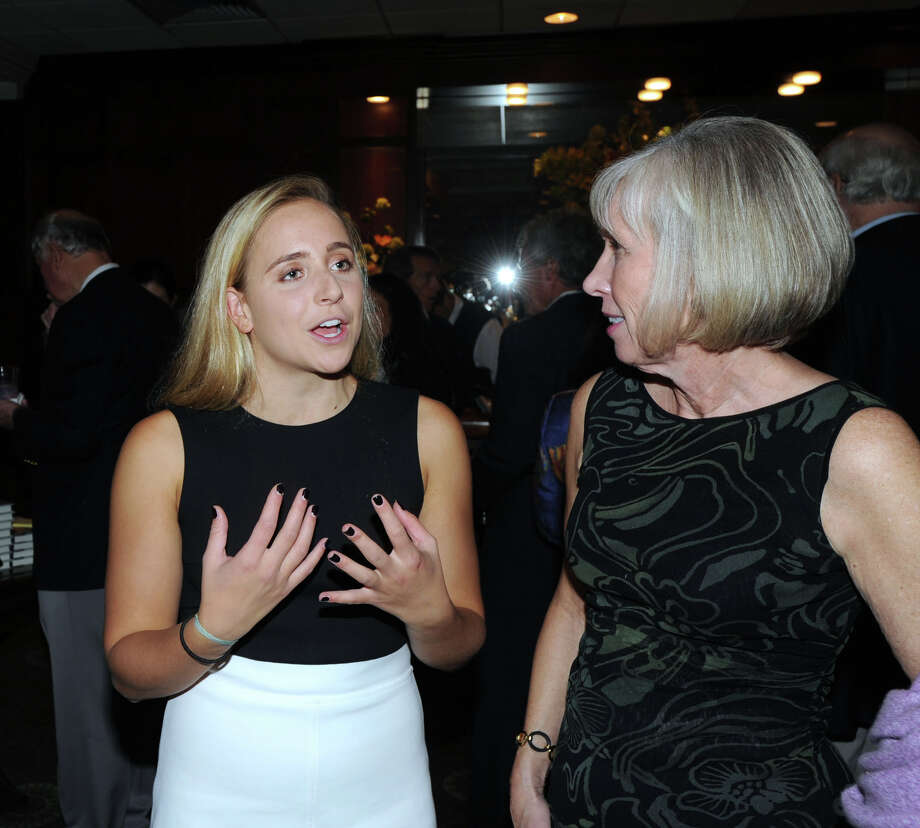 "At left, Greenwich High School senior Olivia Hallisey, 18, speaks with Debra Mecky, the executive director of the Greenwich Historical Society during the society's ""An Evening with Lesley Stahl"" at the Greenwich Country Club, Greenwich, Conn., Wednesday night, Oct. 5, 2016. Hallisey was honored with a Greenwich Makes History award during the event for being a 2015 Google Science Fair Grand Prize Winner. Stahl, an awarding winning broadcast journalist was on hand to promote her book ""Becoming Grandma: The Joy and Science of the New Grandparenting."" Stahl also spoke during the event. Photo: Bob Luckey Jr. / Hearst Connecticut Media / Greenwich Time"