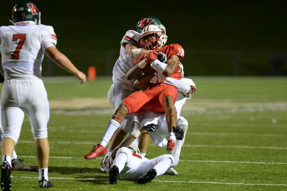 Katy defeated The Woodlands 14-7 in a defensive battle Sept. 11, 2015 at Rhodes Stadium in Katy. The non-district rivals exchange pleasantries again Sept. 9 at Woodforest Stadium. Photo: Craig Moseley