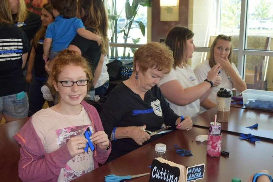 """The group made 1,700 blue ribbons and collected cards written by children to say, """"Thank you."""""""