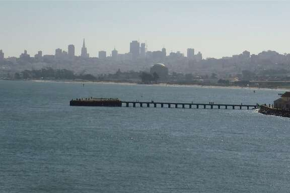 From the top of Fort Point, the view of Torpedo Wharf, the San Francisco shoreline leading to the dome of the Palace of Fine Arts and beyond to the City's skyline