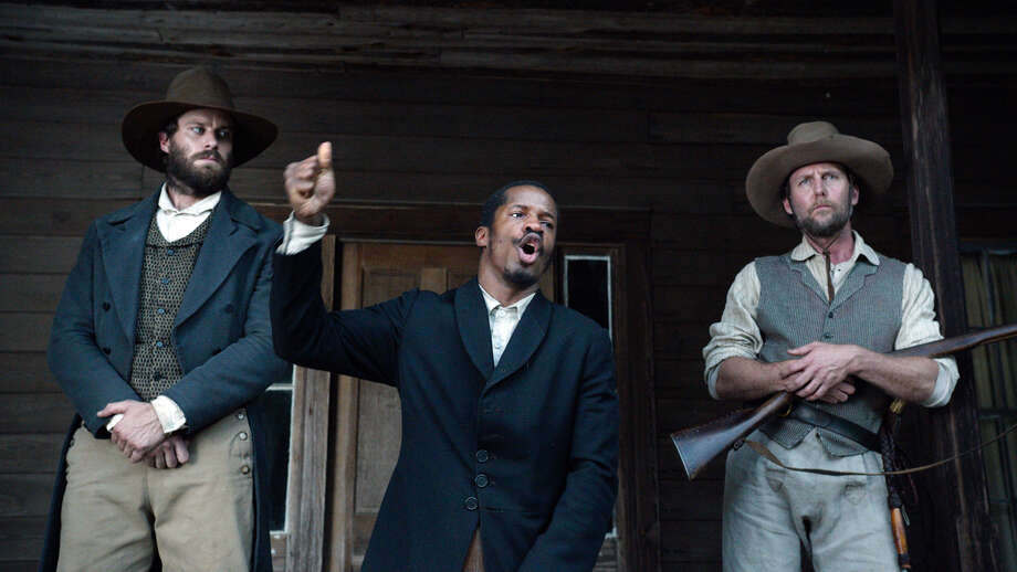"""In this image released by Fox Searchlight Pictures, from left, Armie Hammer portrays Samuel Turner, Nate Parker portrays Nat Turner and Jayson Warner Smith portrays Earl Fowler in a scene from """"The Birth of a Nation,"""" opening Oct. 7, 2016. (Fox Searchlight Pictures via AP) Photo: HONS / Fox Searchlight"""
