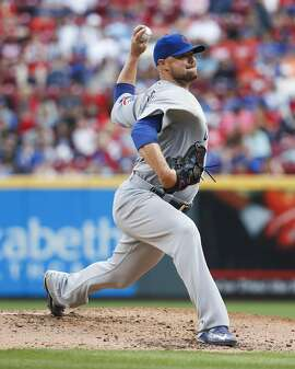Chicago Cubs starting pitcher Jon Lester throws in the second inning of a baseball game against the Cincinnati Reds, Saturday, Oct. 1, 2016, in Cincinnati. The Reds won 7-4. (AP Photo/John Minchillo)