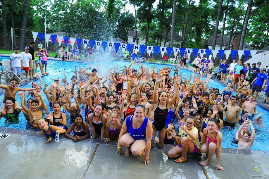 Morgan Burcham organized 296 students and adults together to set a new swiming record for most swimmers swimming for one hour. Photo: Photographer