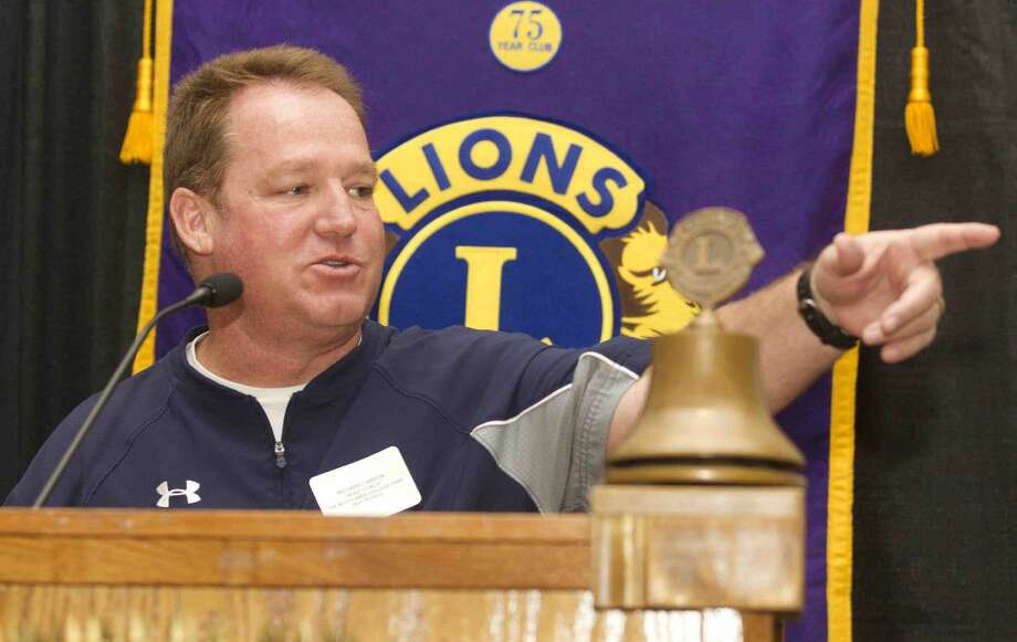 College Park head coach Richard Carson talks about the upcoming season during the Conroe Noon Lions Club's annual Pigskin Preview at the Lone Star Convention Center Wednesday.