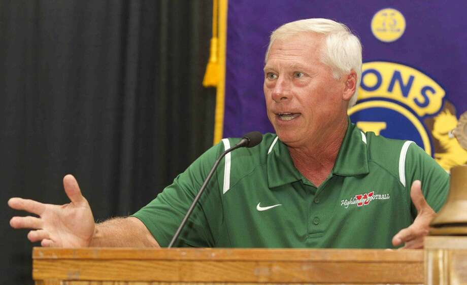 The Woodlands head coach Mark Schmid talks about returning players during the Conroe Noon Lions Club's annual Pigskin Preview at the Lone Star Convention Center Wednesday.