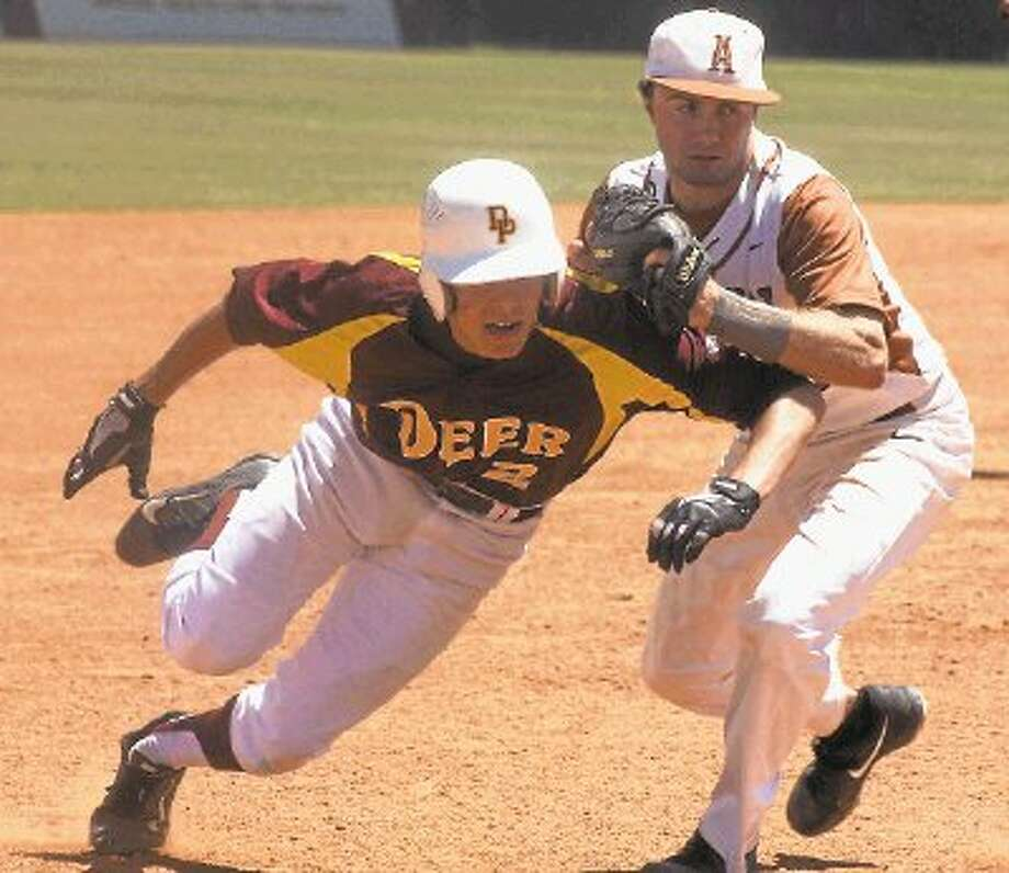 Deer Park's Cameron Thompson gets tagged out by Alvin's third baseman during the critical play in the sixth inning last Saturday. Photo: Robert Avery / @WireImgId=2674606
