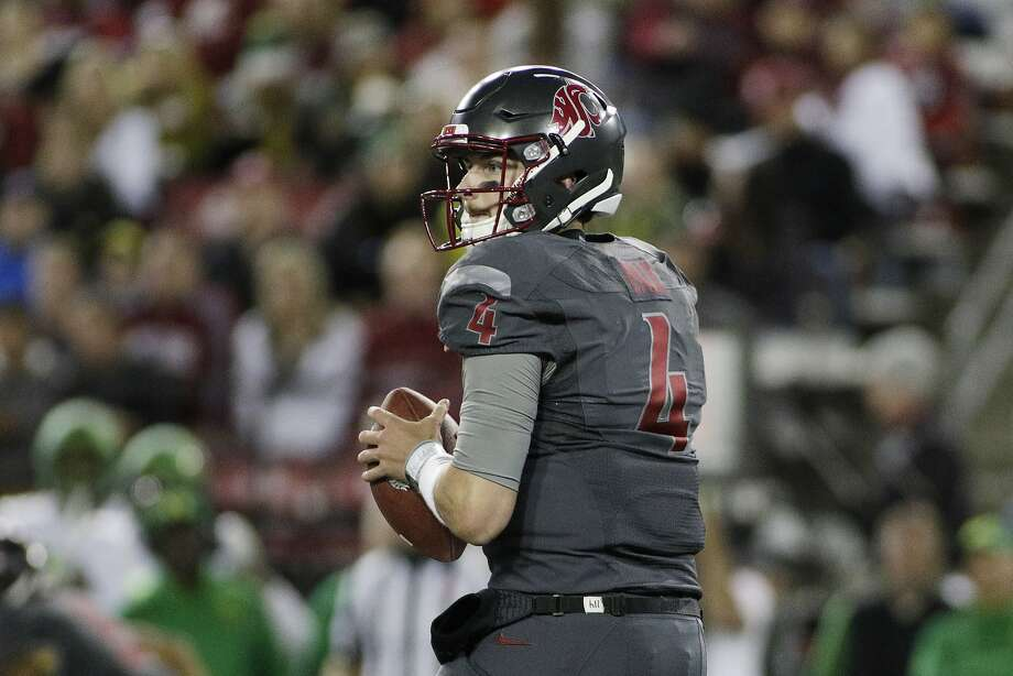 Washington State quarterback Luke Falk, a junior, is the nation's active career leader in passing yards per game with 360. Photo: Young Kwak, Associated Press