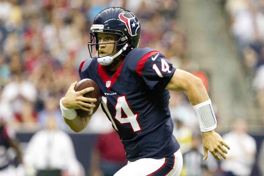 Houston Texans quarterback Ryan Fitzpatrick (14) runs the ball in the first quarter of an NFL preseason game at NRG Stadium Saturday. Go to HCNpics.com to view more photos from the game.