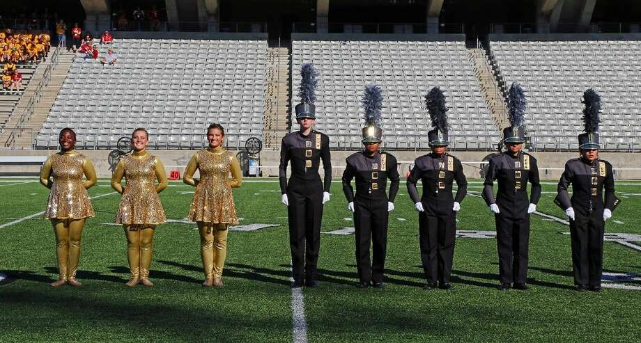 The Cypress Falls drum majors stand on the Berry Center field at the prelims retreat during the UIL Area E Marching Contest on Oct. 25. Photo: Submitted Photo