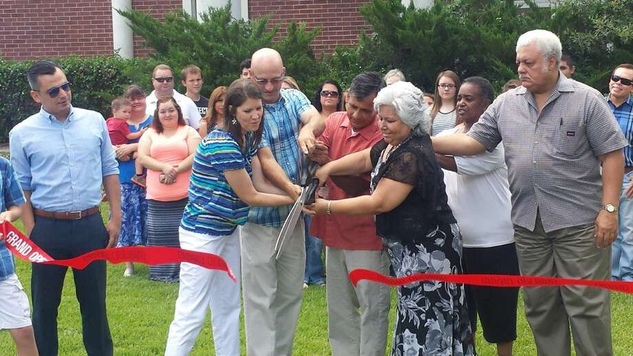 Housed at Impact Church, community and church members came together to celebrate the opening of the new center with a ribbon cutting ceremony and lunch on Saturday as well as commemorate an idea come to fruition.