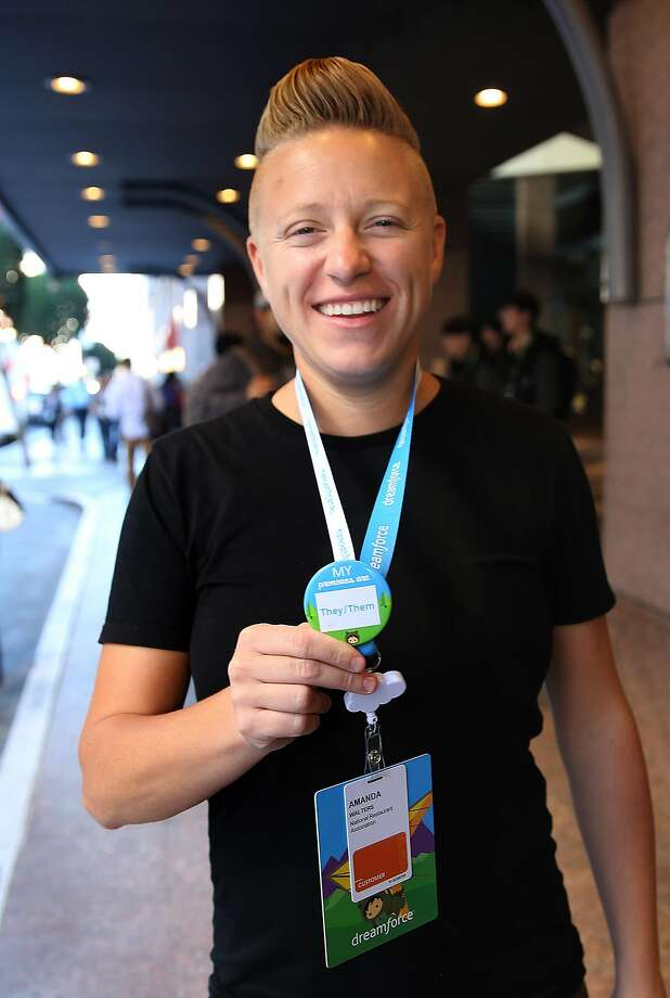 Senior business analyst Ryan Walters decided to wear a pronoun badge during Dreamforce '16' on Thursday, October 6, 2016, in San Francisco, Calif. Photo: Liz Hafalia, The Chronicle