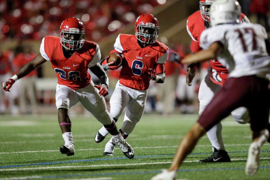 Alief Taylor wide receiver Myron Smith (6) follows the blocking of Jesse Walker (22) during last week's 19-14 victory over Pearland at Crump Stadium. Photo: Tim Warner, Freelance / Houston Chronicle