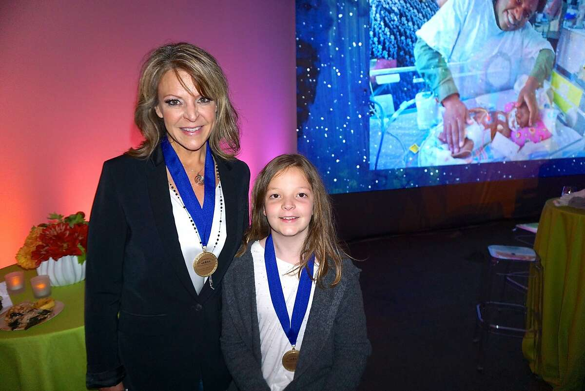 Kim Tramel and her daughter, former UCSF patient Josslyn Tramel, were honored with the UCSF Gen. Colin Powell Medal of Courage at the Concert for the Kids at the Cow Palace. Oct. 2016.