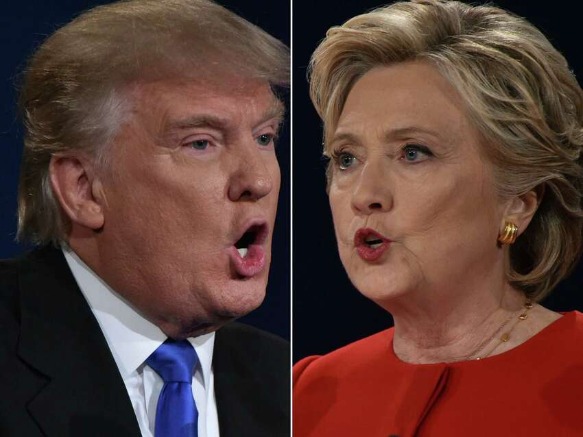 Republican nominee Donald Trump and Democratic nominee Hillary Clinton face off during the first presidential debate at Hofstra University in Hempstead, New York on September 26, 2016. / AFP PHOTO / Paul J. RichardsPAUL J. RICHARDS/AFP/Getty Images