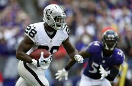 Oakland Raiders running back Latavius Murray rushes the ball in the second half of an NFL football game against the Baltimore Ravens, Sunday, Oct. 2, 2016, in Baltimore. (AP Photo/Gail Burton)