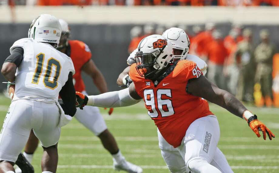 Oklahoma State defensive tackle Vincent Taylor moves in to tackle Southeastern Louisiana quarterback D'Shaie Landor on Sept. 3, 2016, in Stillwater. Photo: Sue Ogrocki /Associated Press / AP