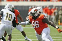 Oklahoma State defensive tackle Vincent Taylor moves in to tackle Southeastern Louisiana quarterback D'Shaie Landor on Sept. 3, 2016, in Stillwater.