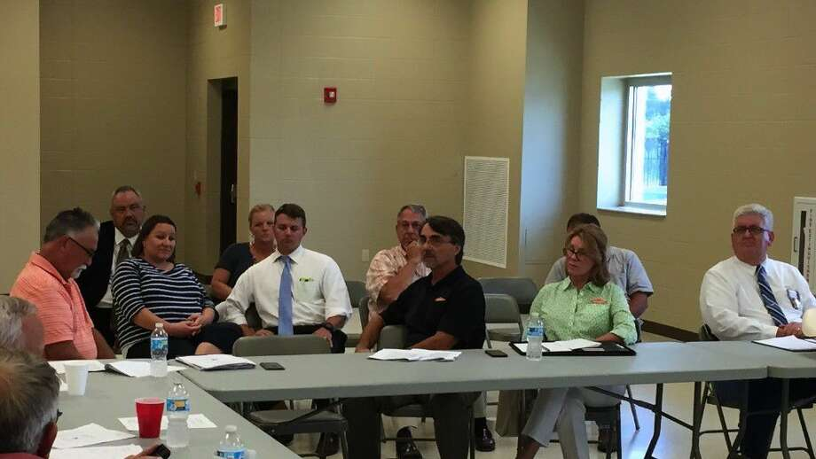 Bill Callahan, owner of SERVPRO (seated at the table at center), described the levels of airborne mold recently detected in a few areas of the Liberty County courthouse to be only mildly elevated over the levels normally found outdoors. ADA Ragis Fontenot and County Treasurer Kim Harris (seated in the back row), along with their staff, will have to vacate their offices for a few days while they are cleaned. Photo: Casey Stinnett