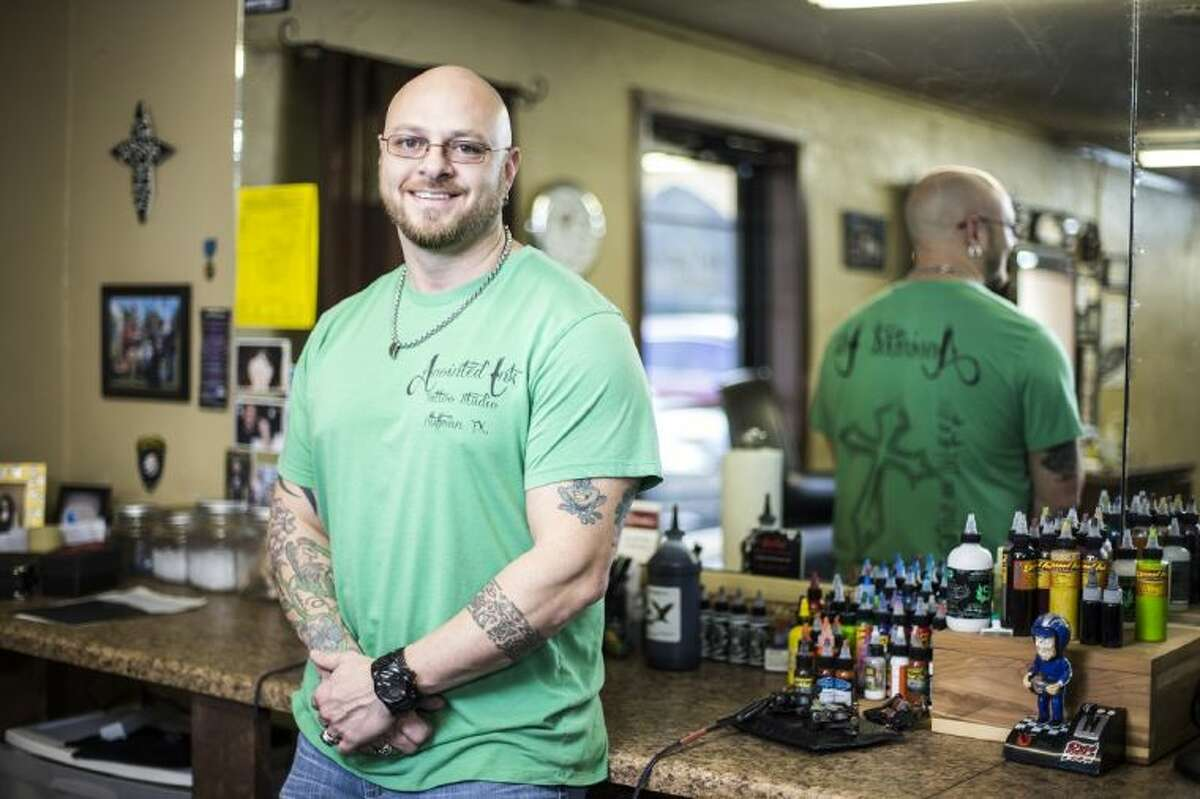 Anointed Ink owner and artist Scott Hill poses for a portrait at his shop Feb. 19, 2014, in Huffman. Hill uses his shop and his ink to minister to those who wouldn't normally be reached by a suit-and-tie minister.