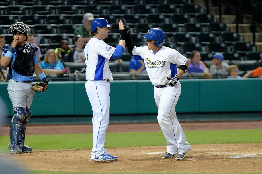 Sugar Land's Patrick Palmeiro high fives Wilfredo Rodriguez after Rodriguez's home run against Southern Maryland. The Skeeters return to Constellation Field for a three-game series against Somerset after a 7-3 road trip. Photo: Craig Moseley