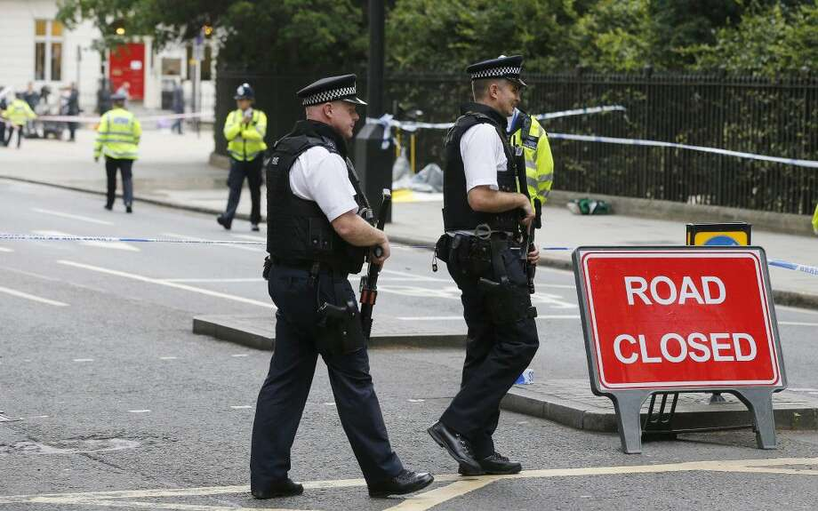 Police guard the scene of a knife attack near Russell Square in London, Thursday. Terrorism is being examined as a potential motive for a knife rampage at Russell Square, central London, that left one woman dead and five others injured.
