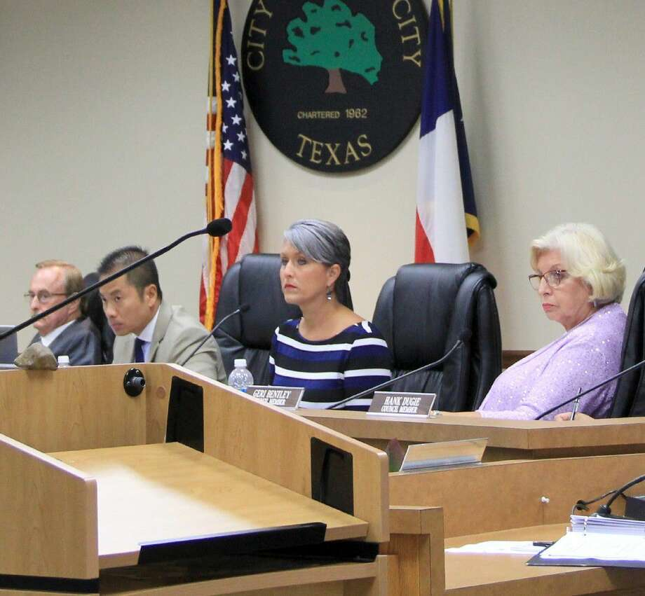 """League City elected officials got an earful from city residents who called some of their recent actions """"petty"""" and """"embarrassing"""" at a council meeting held Tuesday, June 26. Pictured from left: Mayor Pat Hallisey, City Attorney Nghiem Doan, City Councilmembers Heidi Hansing and Geri Bentley Photo: Kristi Nix"""