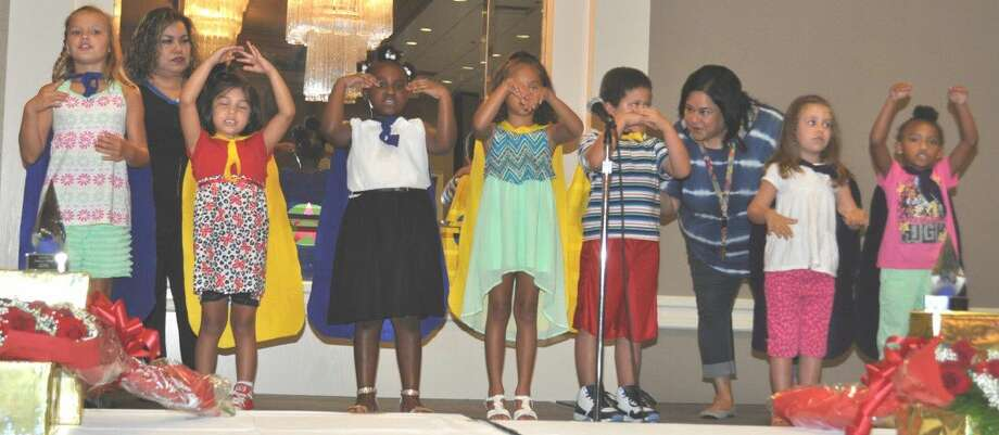 The Children from Little Heros put on a special program with their singing and animation.