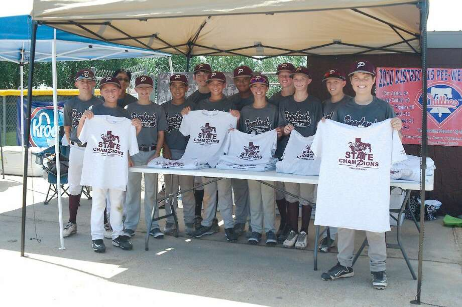 Members of the Pearland East Little League team take time away from practice to display the T-shirts they are selling to raise money for the trip to the Little League Southwest Region tournament which begins this week in Waco. Photo: Kirk Sides