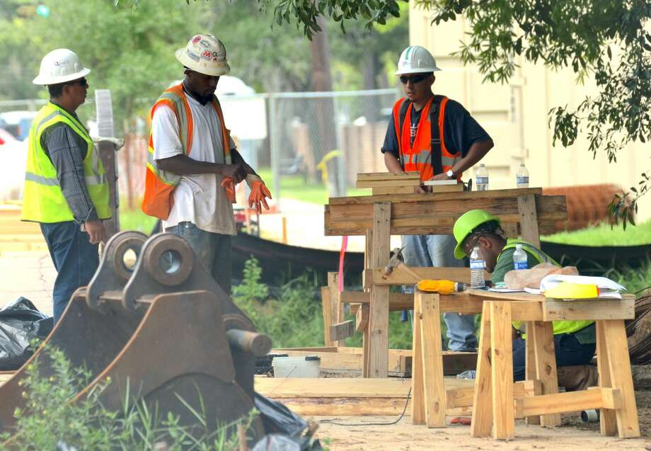 Crews work to complete the Memorial Drive bridge just east of Gessner Road on Tuesday. The Texas Department of Transportation has been working on the bridge in Bunker Hill Village since April. Photo: By Jay R. Jordan