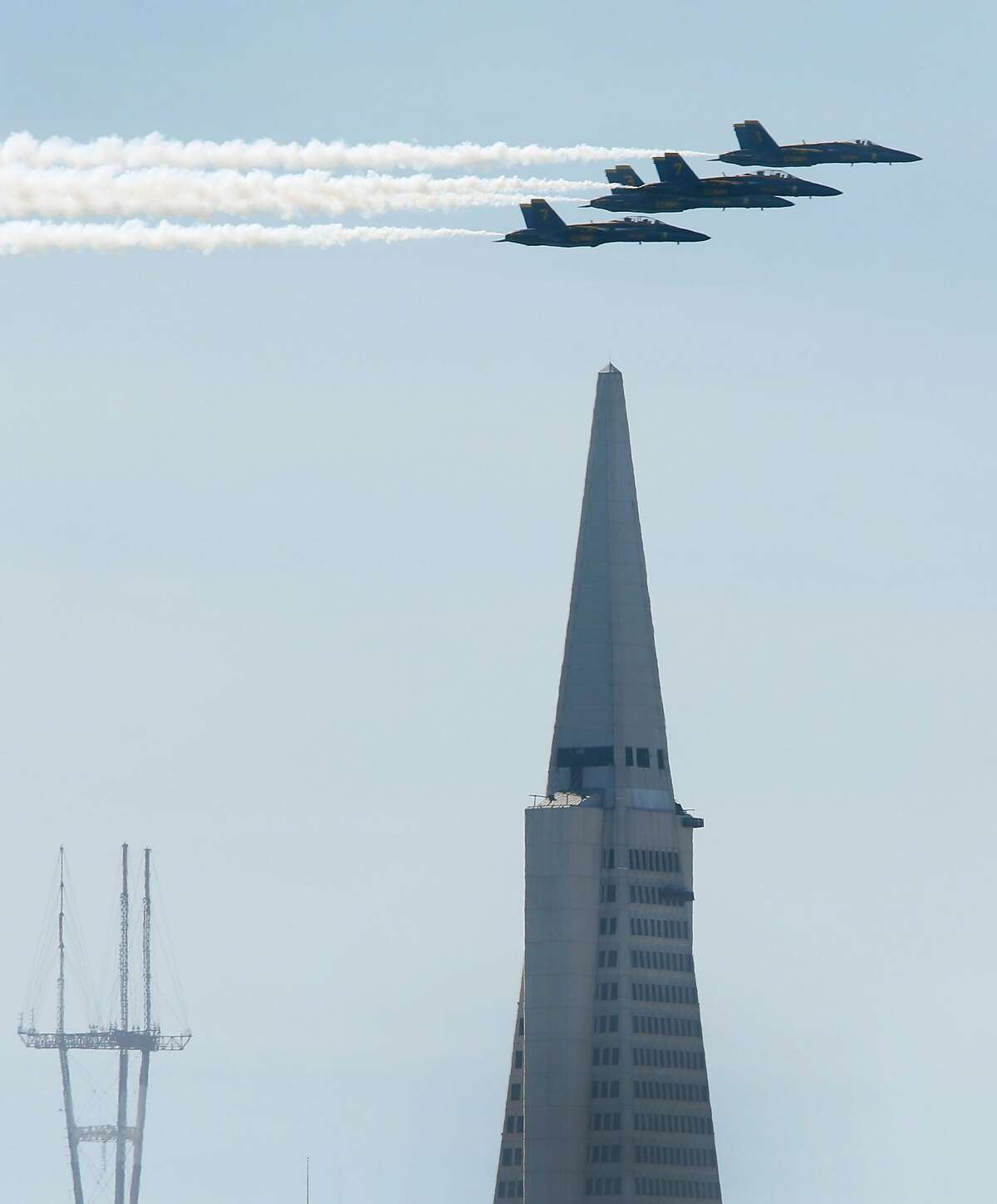 The Blue Angels fly past Sutro Tower and the Transamerica Pyramid on a practice flight for this weekend's Fleet Week air shows in San Francisco, Calif. on Thursday, Oct. 6, 2016.