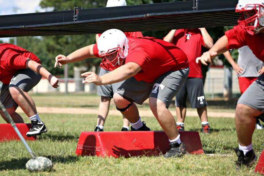 Tomball's William McElvogue, center, runs a drill with teammates during practice on Tuesday, Aug. 12, 2014, at Tomball High School. Photo: Michael Minasi